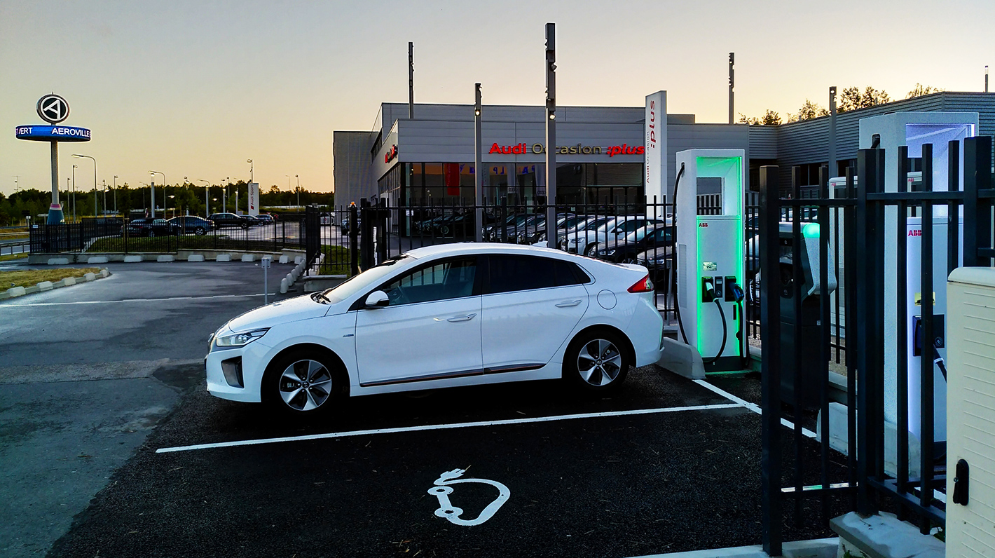 Electric vehicle charging at a Chargemap Pass compatible Allego charging station